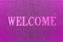Welcome Purple Door Mat. Welcome Carpet Background. Royalty Free Stock Photography