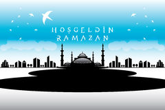 Welcome Ramadan mosque and Vector crafted design. Islamic Calligraphy of shiny text Ramadan Kareem or Ramadan with silhouette of Mosque or Masjid in moon light Royalty Free Stock Photos