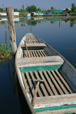 Welcome row boat. Old row boat tied to a post in Kashmir, India royalty free stock image