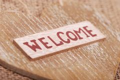 Welcome sign. Image of word welcome on heart symbol wooden background Royalty Free Stock Photography