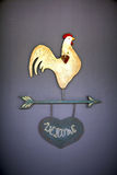 Welcome sign. With a chicken on a wall Stock Images