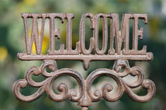 Welcome Sign. Horizontal image of an iron sign spelling out the word Welcom Royalty Free Stock Photography