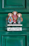 Welcome sign. Hanging at green doors Stock Photography