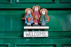 Welcome sign. Hanging at green doors Royalty Free Stock Photos