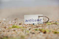 Welcome - sign on the beach.  Royalty Free Stock Image