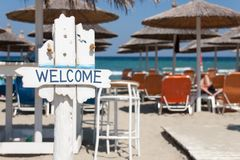 Welcome sign on beach bar stock images