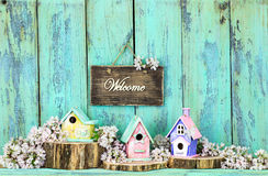 Welcome sign with birdhouses and flowers Royalty Free Stock Photos