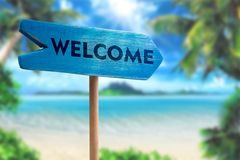 Welcome sign board arrow. On beach with sunshine background Stock Images