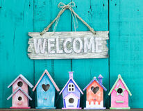 Welcome sign with bow by collection of birdhouses Stock Image