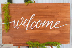 Welcome sign. On brown wood Stock Images