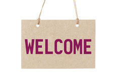 Welcome sign from cardboard paper hanging on rope Stock Photography