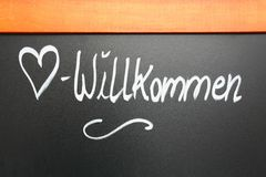 Welcome sign on a chalkboard, Germany. Stock Photo