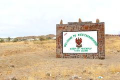 Welcome sign clean area Keetmanshoop, Namibia. Welcome sign and sign to keep the town clean on a monument in Keetmanshoop, Namiba Stock Image