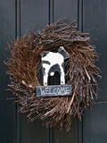 Welcome sign with cow in wreath Stock Image