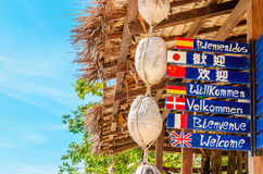 Welcome sign in different languages on beach Royalty Free Stock Images