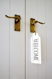 Welcome sign on a door Stock Images