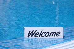 Welcome Sign And Empty Swimming Pool Surface In The Background Royalty Free Stock Photo