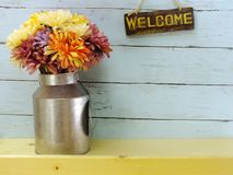 Welcome sign and flower bouquet with space copy background. Welcome sign and flower bouquet with space copy on wooden background stock image