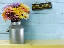 Welcome sign and flower bouquet with space copy background. Welcome sign and flower bouquet with space copy on wooden background royalty free stock image