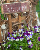 Welcome sign and flowers Royalty Free Stock Photography