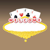 Welcome sign with four aces playing cards and heap of golden coins Stock Photos
