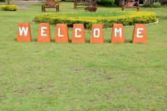 Welcome sign on green grass Royalty Free Stock Photography