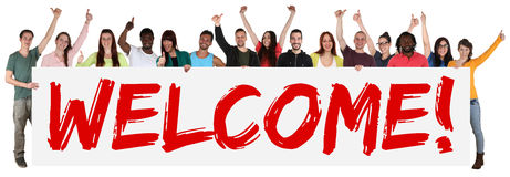 Welcome sign group of young multi ethnic people holding banner Royalty Free Stock Images