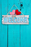 Welcome sign hanging on aged wood door Royalty Free Stock Image