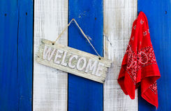 Welcome sign hanging by red paisley bandanna Royalty Free Stock Image