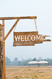 Welcome sign hanging on rope Stock Photo