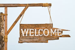 Welcome sign hanging on rope Stock Image
