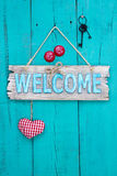 Welcome sign hanging on rustic wood door royalty free stock image
