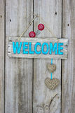Welcome sign with hearts hanging on door Royalty Free Stock Photos