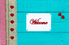 Welcome sign with hearts hanging on door Royalty Free Stock Image