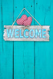 Welcome sign with hearts hanging on door Royalty Free Stock Photo