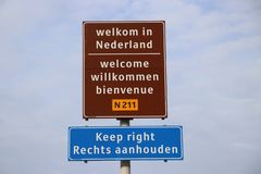 Welcome sign at Hoek van Holland for travelers from England with warning to keep right for driving lane. Welcome sign at Hoek van Holland for travelers from royalty free stock images