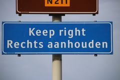 Welcome sign at Hoek van Holland for travelers from England with warning to keep right for driving lane. Welcome sign at Hoek van Holland for travelers from stock photo