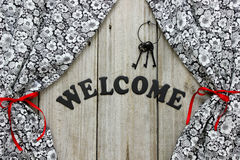 Welcome sign with iron keys and floral curtains Royalty Free Stock Photo