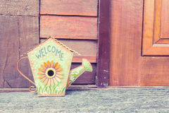 Welcome sign made from iron or metal , it's formed shape as gard. Ening shower and flower texture Stock Images