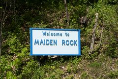 Welcome sign for Maiden Rock, WI. This is a village / small town in Pierce County, Wisconsin, United States along the shores of stock image