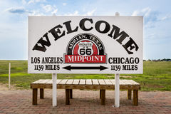 Welcome sign marking the midpoint between Chicago and Los Angeles in the historic Route 66 in Adrian , Texas, USA. Adrian, Texas - July 9, 2014: Welcome sign stock image