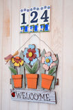 Welcome sign with metal colorful  flowers Stock Image