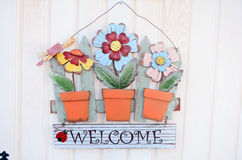 Welcome sign with metal colorful  flowers Royalty Free Stock Image