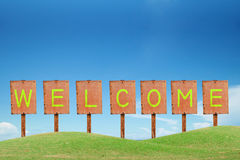 Welcome sign and metal lable Royalty Free Stock Photo