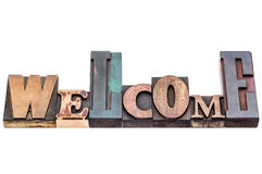 Welcome sign in mixed wood type Stock Photos