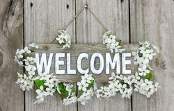 Welcome sign with pear tree blossoms