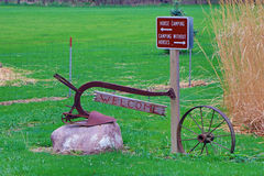 Welcome Sign on a Plow Share and Iron Wheel Stock Images