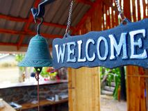 Welcome sign. With ringing bell Stock Image