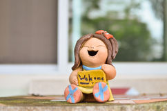Welcome sign stone doll on the table Stock Photography