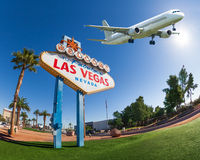 Welcome sign to Las Vegas with airplane in the sky Stock Photography